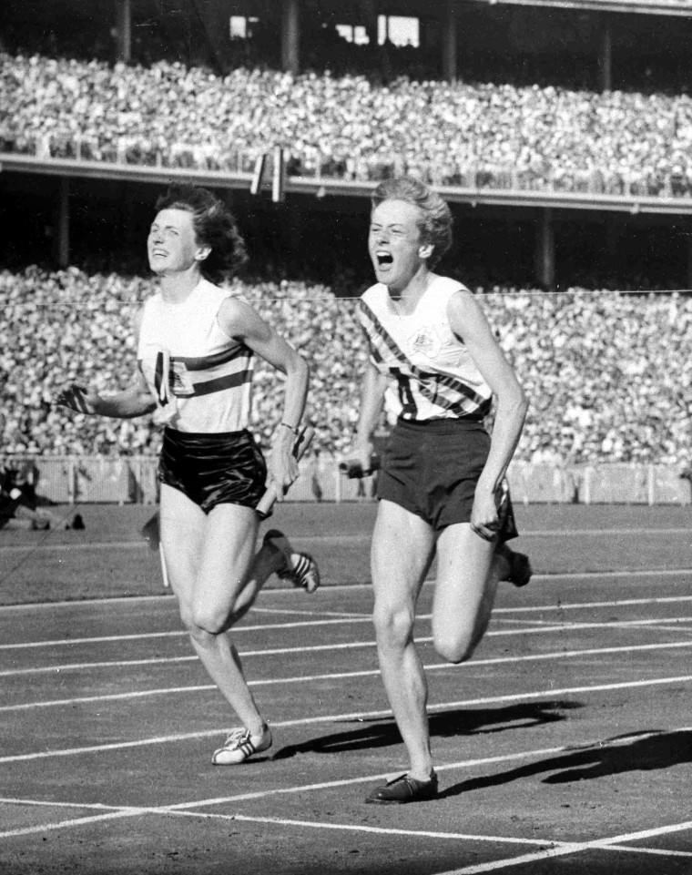 Australia's Betty Cuthbert, right, wins the Women's Olympic Games 4 x 100 metres Relay Final, in a new World Record time of 44.5 seconds, at Melbourne, Australia, Dec. 1, 1956.