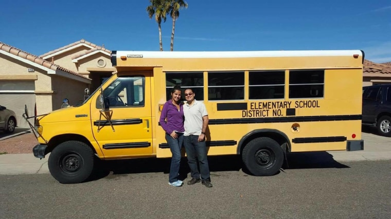 The late Celso Salinas-Mireles and his wife, Ileana in front of the bus they planned to use as they toured cross-country, sharing their music, especially to migrant communities.