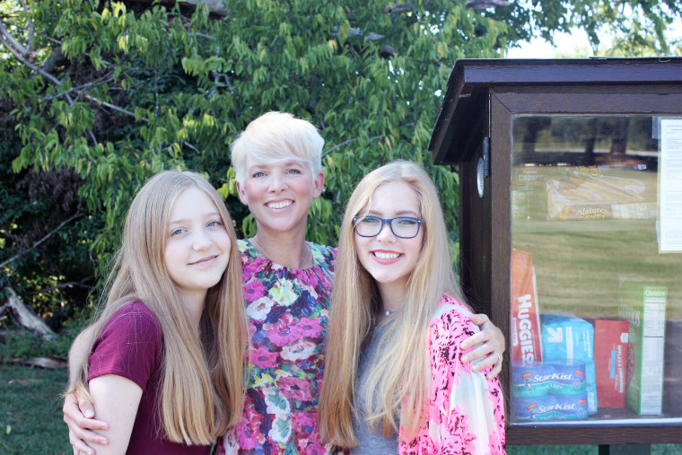 Jessica McClard, with daughters Charly and Grier, came up with the idea for Little Free Pantries after seeing Little Free Libraries crop up in her local community.