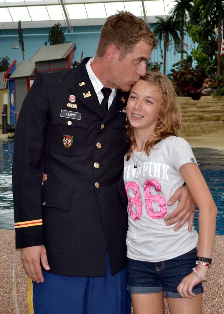 Girl leaps into the arms of her dad in a surprise reunion at the zoo after his military deployment