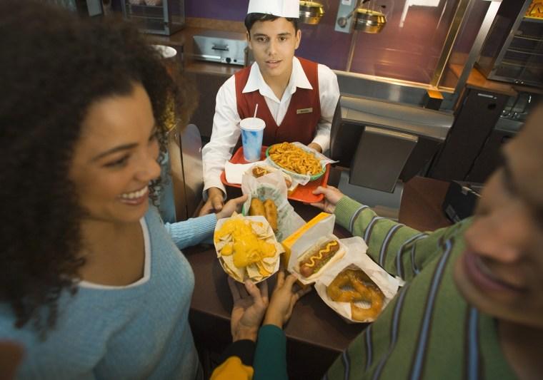 Movie theater concession stand, food, nachos, pretzel, junk food