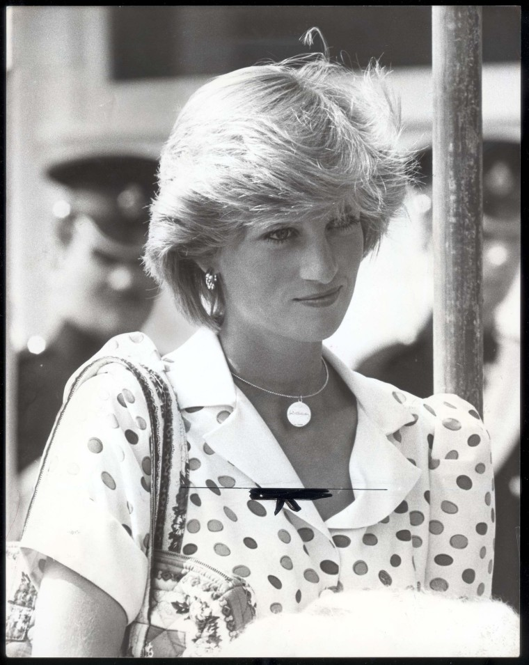 """Princess Diana, wearing a necklace inscribed with """"William,"""" in a 1983 photo."""