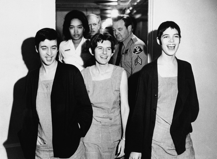 Three co-defendants in the Sharon Tate murder case, from left, Susan Atkins, Patricia Krenwinkel and Leslie Van Houten, laugh as they walk to court in Los Angeles for sentencing, March 29, 1971.
