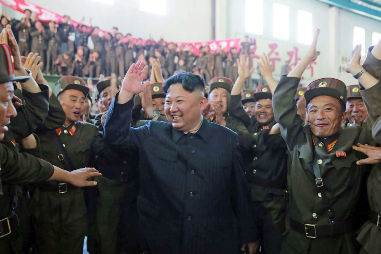 Image: North Korean leader Kim Jong-Un (C) celebrating the successful test-fire of the intercontinental ballistic missile