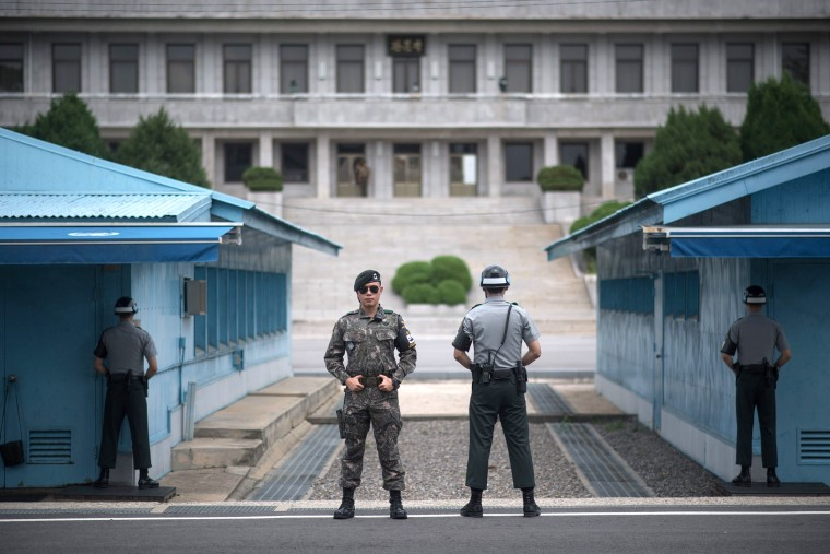 Image: outh Korean soldiers stand guard before North Korea's Panmon Hall