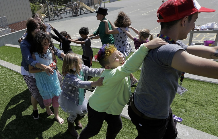 Image: campers and camp counselors dance at the Bay Area Rainbow Day Camp in El Cerrito, Calif.