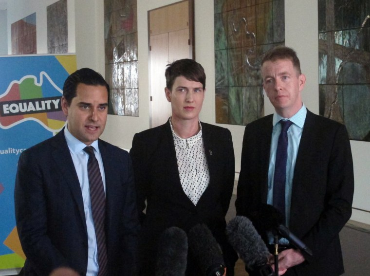 Image: marriage equality advocates Alex Greenwich, Anna Brown and Teirnan Brady address the media at Parliament House in Canberra, Australia