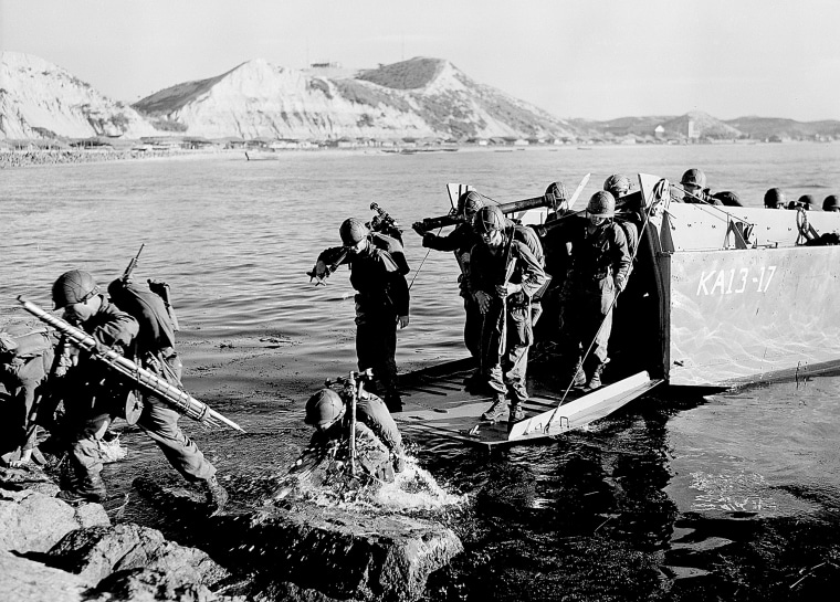 Troops of the First U.S. Cavalry Division land ashore at Pohang on the east coast of Korea on July 19, 1950.