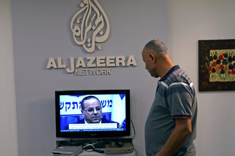Image: An employee working inside the office of Qatar-based Al-Jazeera network in Jerusalem