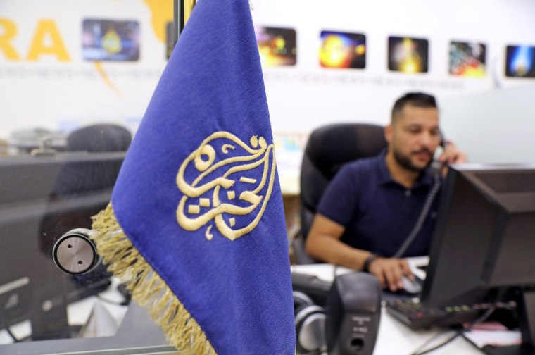 Image: An employee works inside the office of the Qatar-based Al-Jazeera network in Jerusalem