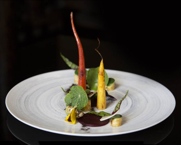 A dish featuring zucchini, carrot, beet, and chive puree from chef Niki Nakayama's n/naka restaurant in Los Angeles.