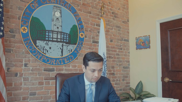 Mayor James Diossa works in his office in Central Falls, RI.