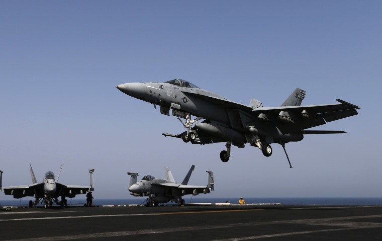 Image: A F/A-18E comes in to land onboard USS George H.W. Bush in the Gulf