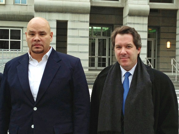 """Image: """"Fat Joe,"""" left, whose real name is Joseph Cartagena, leaves court with his attorney Jeffrey Lichtman"""