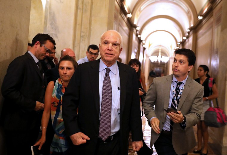 "Image: Sen. John McCain, R-Ariz., leaves the Senate chamber at the U.S. Capitol after voting on the GOP ""Skinny Repeal"" health care bill"