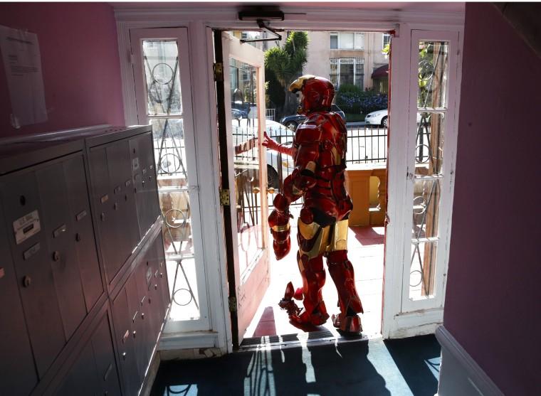 Image: Paul Louis Harrell leaves his apartment building