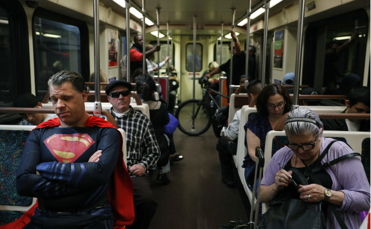 Image: Justin Harrison rides a train