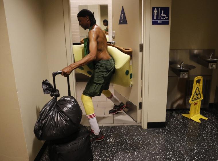 Image: Belnarr Golden  enters a public restroom