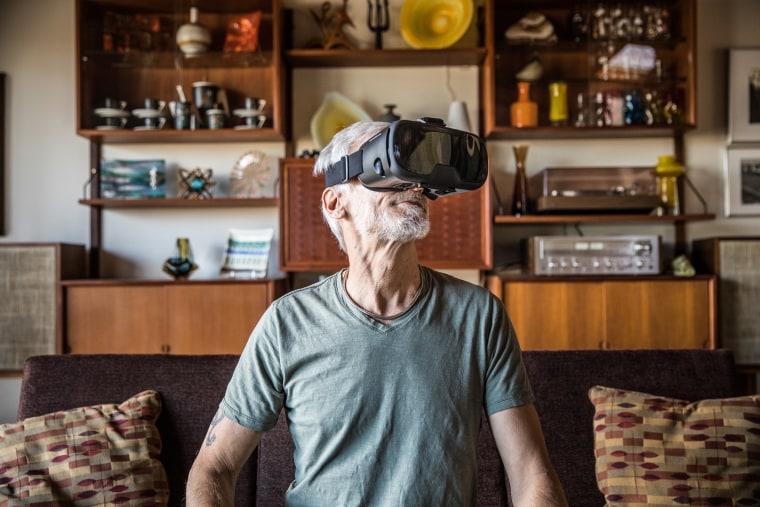 Man (60yrs) wearing virtual reality goggles