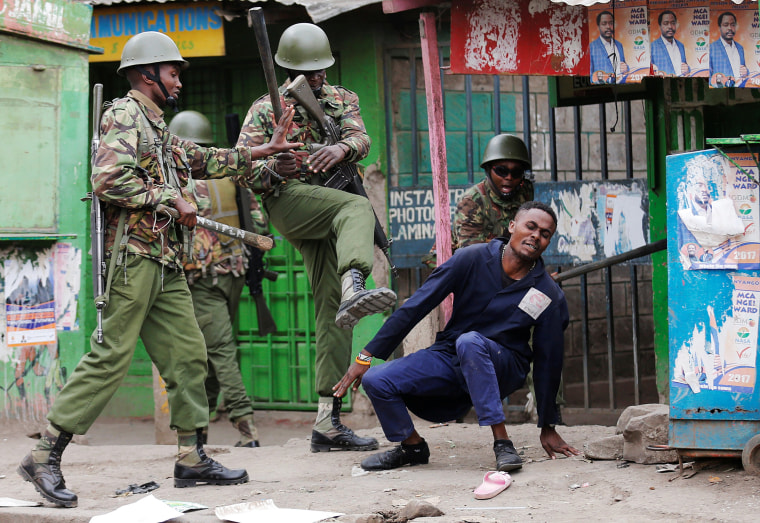 Image: Anti riot policemen disperse people from the street in Mathare, in Nairobi
