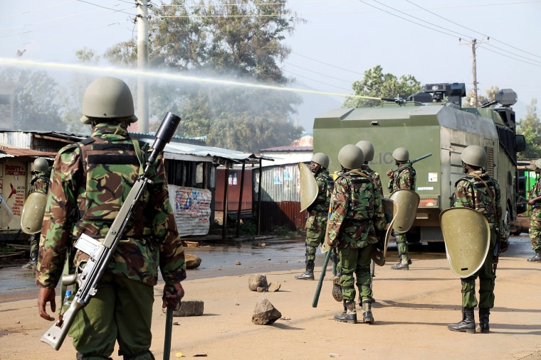 "Image: Kenyan riot policemen use a water canon toward demonstrators supporting opposition leader Raila Odinga, after their political leader claimed ""massive"" fraud in this week's elections, in Kisumu"