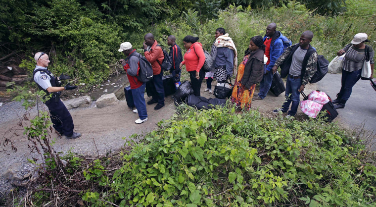Image: Migrants Crossing to Canada