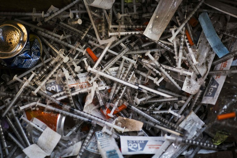 Image: Discarded needles at a heroin encampment
