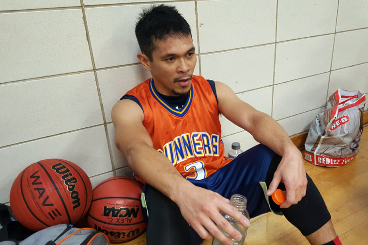 Julius Paragas rests after playing basketball.
