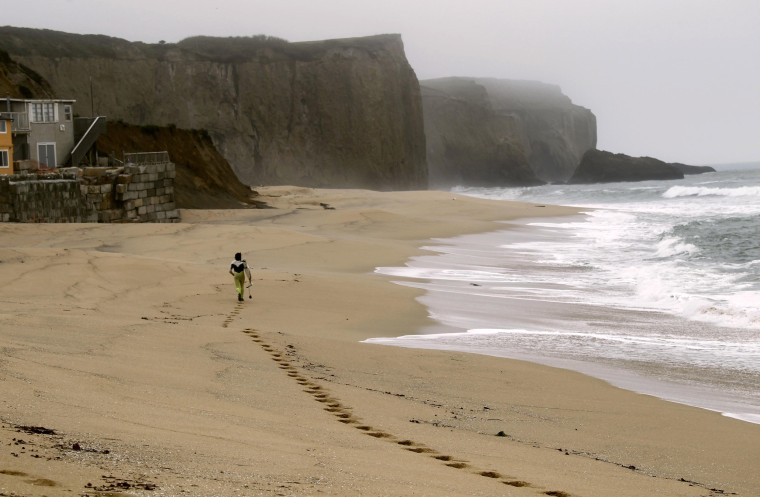 Image: Surfer Demacedo at Martin's Beach in Half Moon Bay