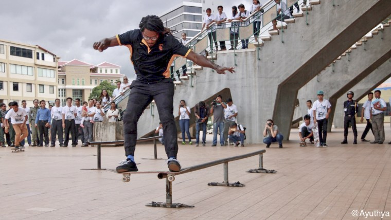 Neftalie Williams doing a nollie lipside during a State Department program in Cambodia.