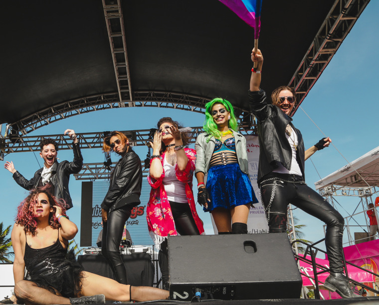 (Right to left) House De Show performers Iso, Adi love, Molly Jo, Nomi Latoken, Anoma Lía and Chris Griandher ending a performance at San Juan's pride parade, celebrated in March 2017
