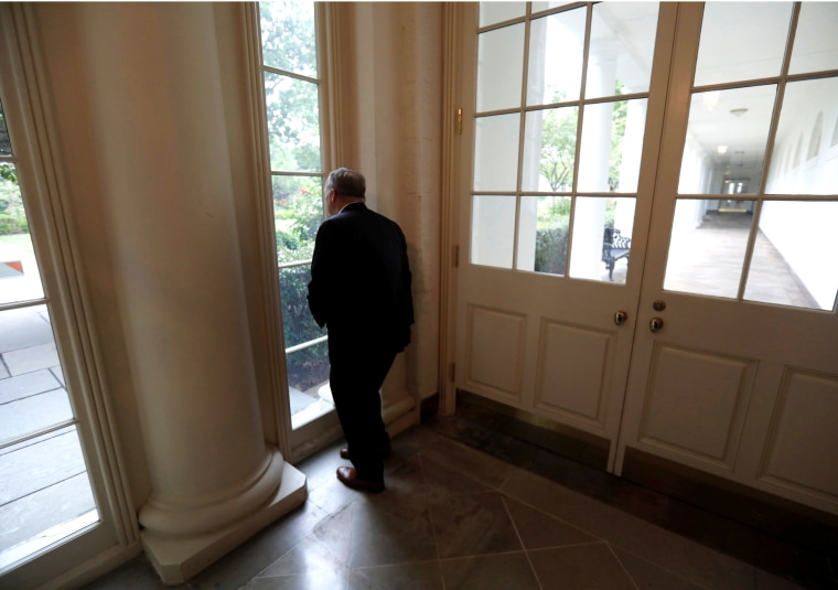 Image: Former White House Press Secretary and Communications Director Spicer looks out the window