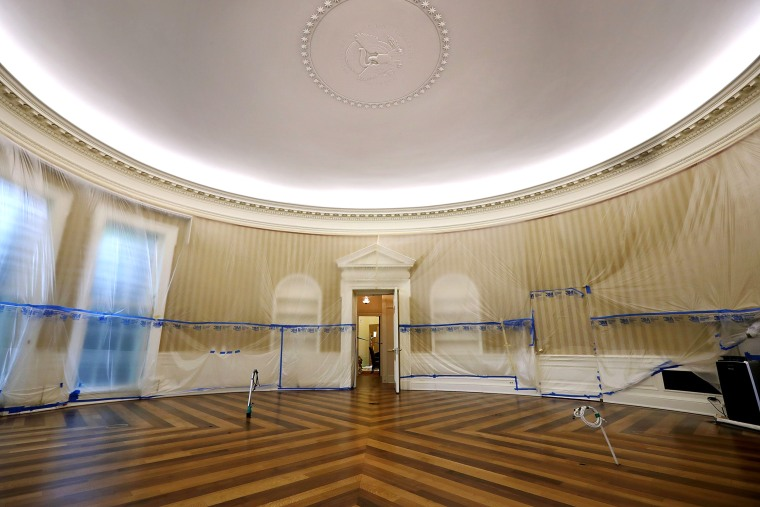 Image: The Oval Office sits empty and the walls covered with plastic sheeting