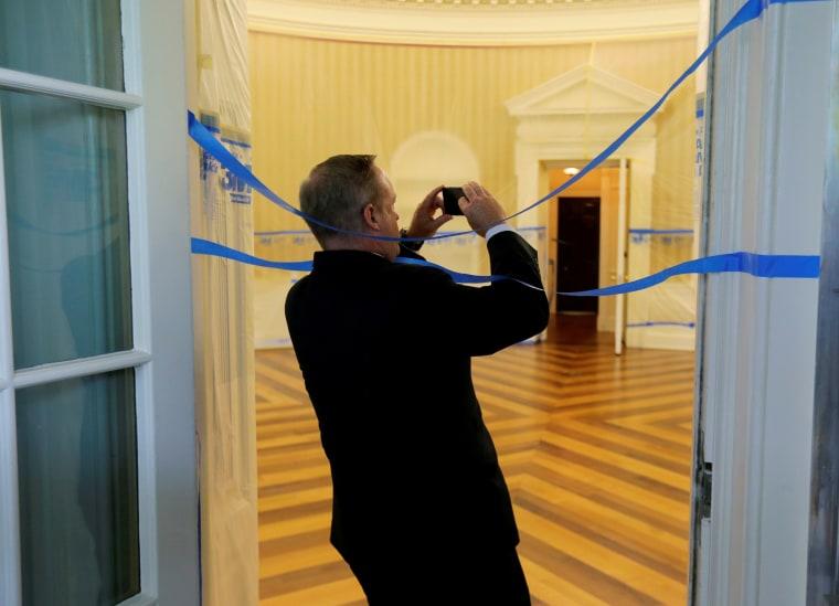 Image: Former White House Press Secretary Spicer wraps himself in tape