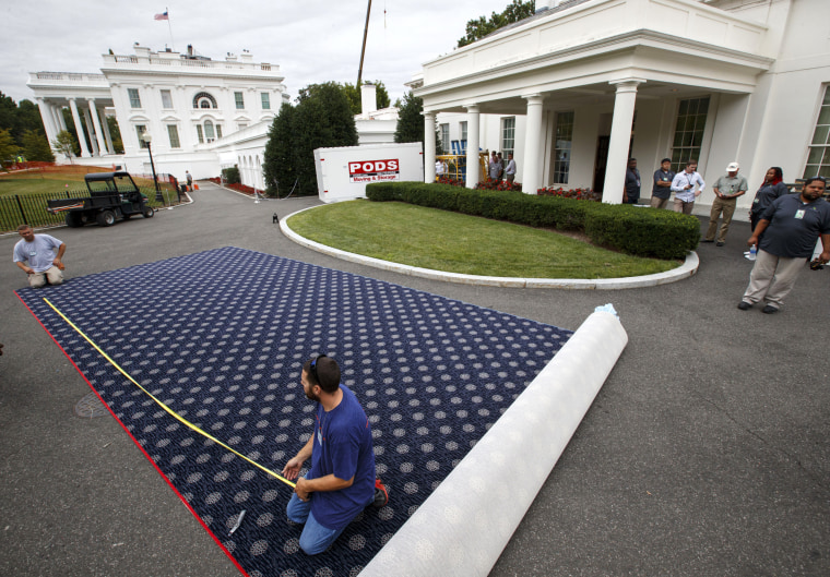Image: Workmen prepare new carpeting for the West Wing of the White House