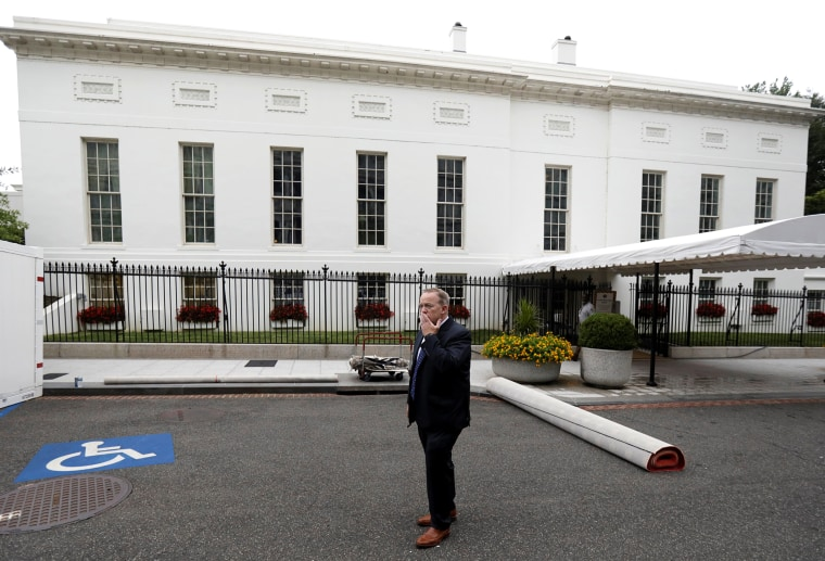 Image: Former White House Press Secretary and Communications Director Spicer stands outside the West Wing of the White House in Washington