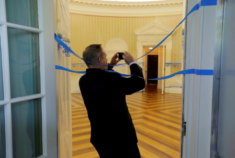 Image: Sean Spicer takes photos of the Oval Office emptied of all furniture