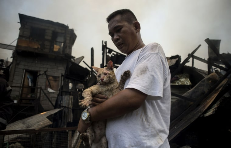 Image: TOPSHOT-PHILIPPINES-ACCIDENT-FIRE