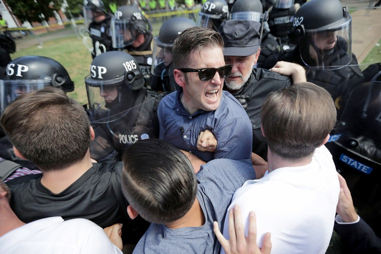 "Image: White nationalist Richard Spencer and his supporters clash with Virginia State Police in Lee Park after the ""United the Right"" rally was declared an unlawful gathering Aug. 12, 2017 in Charlottesville, Virginia."