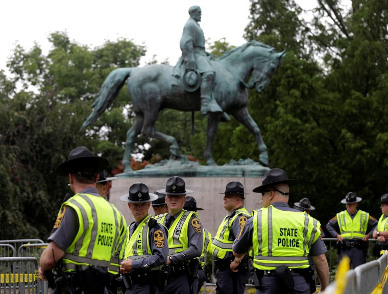 Image: Virginia State Troopers stand under a statue of Robert E. Lee before a white supremacists rally in Charlottesville Virginia