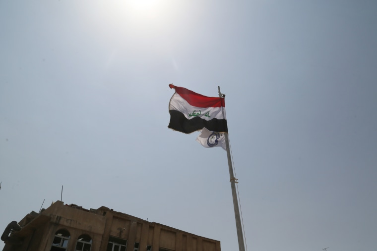 Image: An Iraq flag flies in Mosul, Iraq