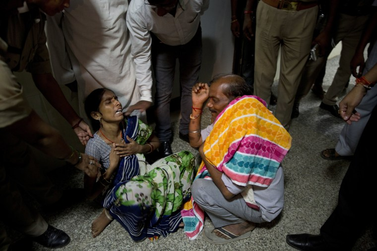 Image: 46-year-old Manthala weeps as she hears the news of the death of her one-month-old son Roshan at Baba Raghav Das Medical College Hospital in Gorakhpur, in the northern Indian state of Uttar Pradesh, Aug. 12, 2017.
