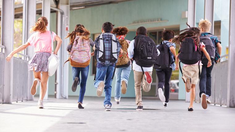 Students running in hallway