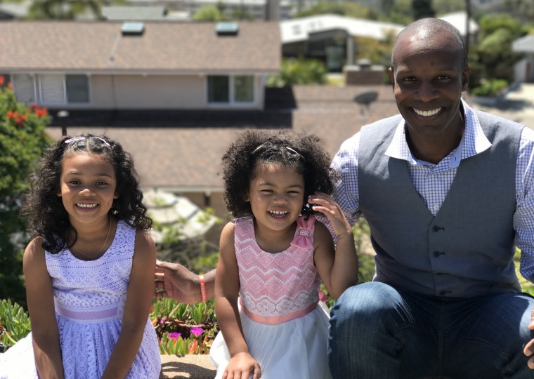Doyin Richards with his two daughters, ages 6 and 4.