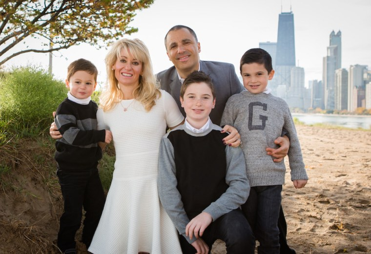 Eirene Heidelberger with her husband and three sons, ages 13, 9, and 5.