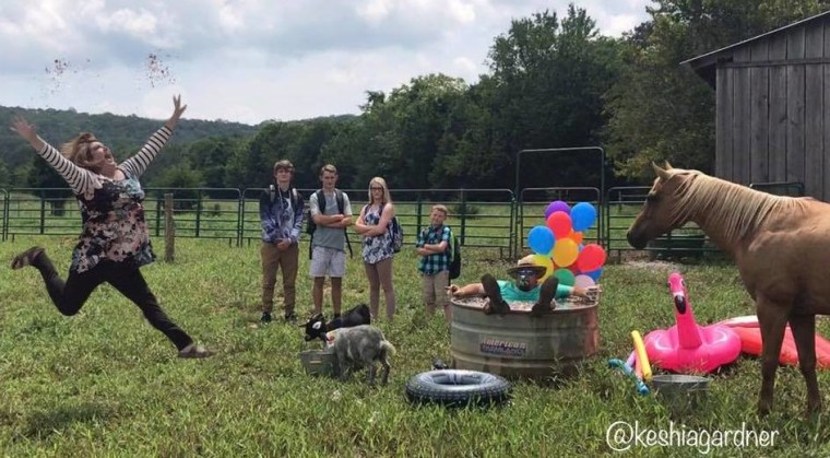 Keshia Gardner with her husband, Andy, their farm animals, and their children.