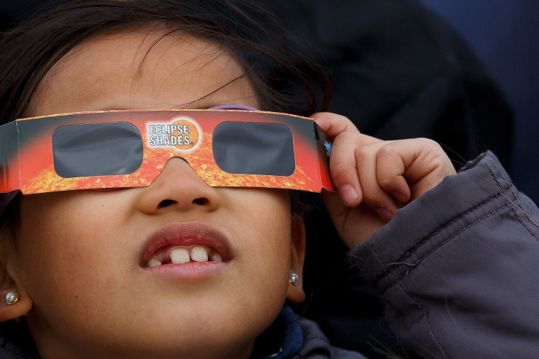 Looking directly at the sun during the eclipse can cause damage to the eye. Experts advise teaching kids caution.