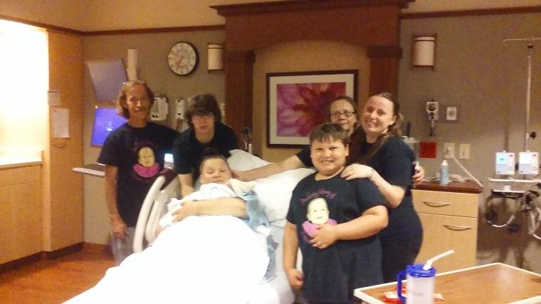 Aleece Geist, Andrew Rector, Zekeiah Geist and family celebrate Mira Rector's birth.