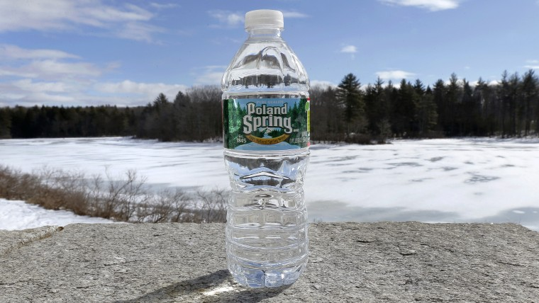 A bottle of Poland Spring water rests on a granite slab in East Derry, N.H., Tuesday, March 5, 2013.