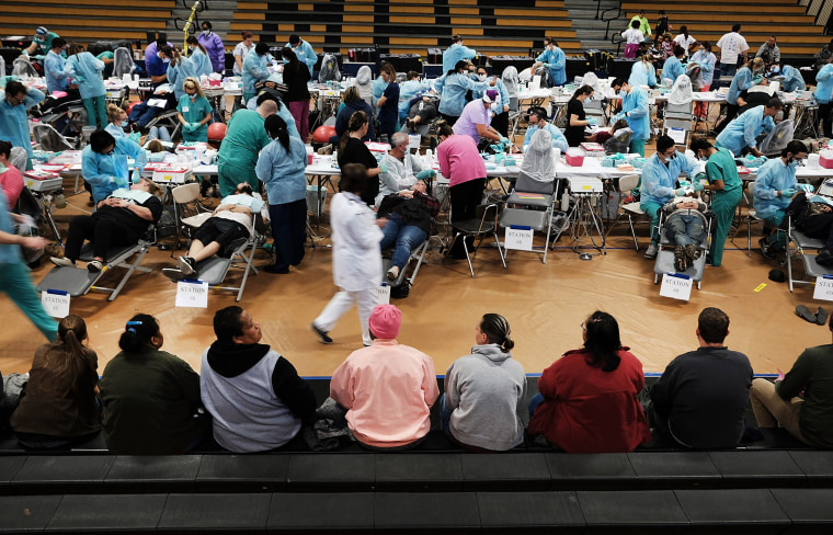 Image: People wait to see a dentist at the Remote Area Medical mobile dental and medical clinic in Milton, Florida